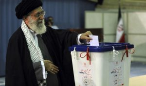 Iranian's elect president: conservatives consolidate vote
