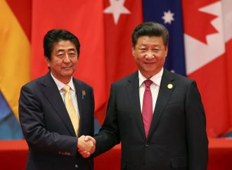 Leaders of China and Japan meet for bilateral summit aimed at building economic ties