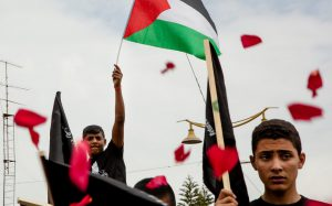 Palestinians march as rising tension between the US and Iran overshadow the region
