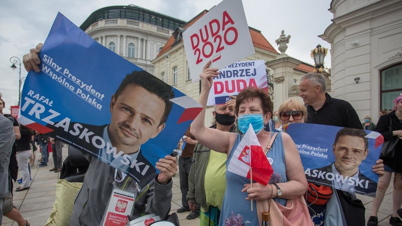 Campaign posters for Duda and Trzaskowski the countrys two major candidates